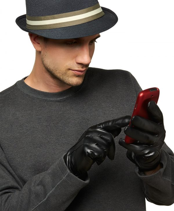 Man in long-sleeve shirt and hat shows the touchscreen ability of the Trailhead Men's Wool-Lined Touchscreen Leather Glove.