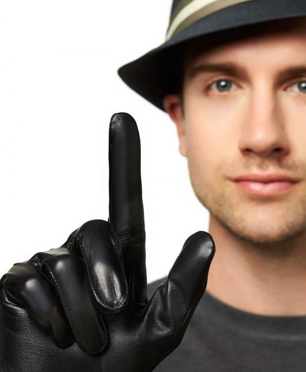Close-up of man pointing one finger up to show the super-soft lambskin leather of the Trailhead Wool-Lined Touchscreen Glove.
